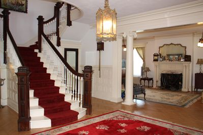 The staircase with a view of the living room.