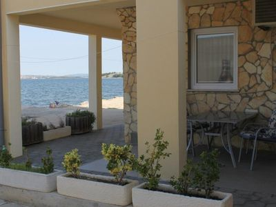 Photo for Two bedroom apartment with terrace and sea view Neviđane, Pašman (A-8453-a)