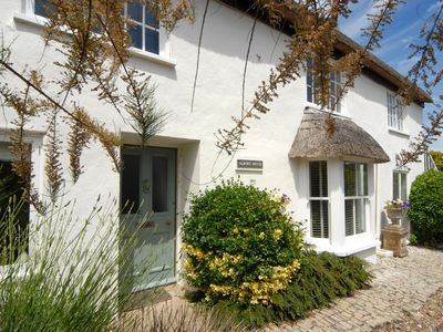 Photo for Albury House is a thatched 17th century cottage in a prominent position within Charmouth