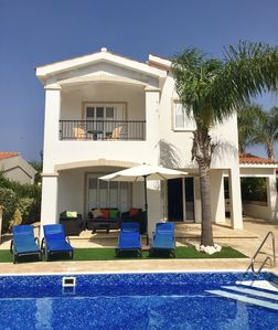 Photo for Luxury Villa in exclusive gated development, 2 mins walk from Coralia Beach.