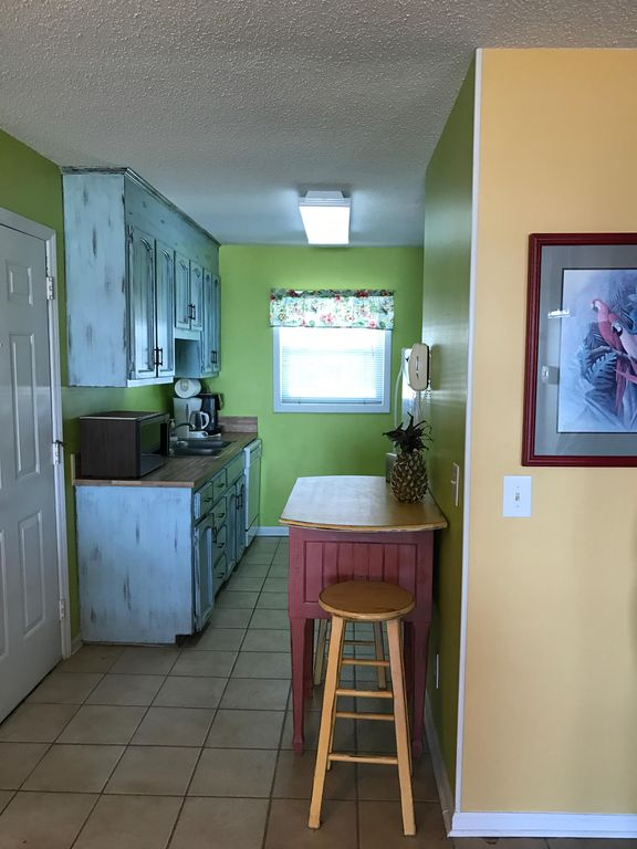 The galley kitchen is easy to work in and has every modern convenience. & 2 BR Condo On the Beach (any closer and you... - VRBO