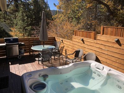 6 Person Hot Tub with 6 patio chairs, table, and Weber grill.