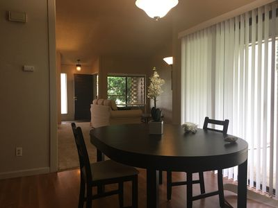 Dining room table comfortably seats six friends.