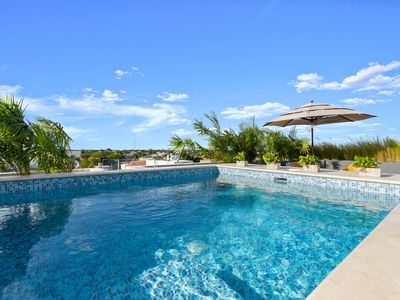 Photo for Relax at a Boutique Apt. With Rooftop Pool & Balcony