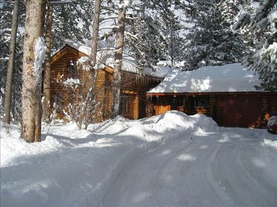 Cabin blanketed in fresh snow.