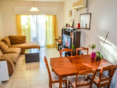 Photo for 2BR family apartment in tourist area beach apartment Wifi, pool, 24h security.