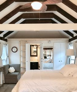 Exposed beamed ceiling with tempurpedic queen