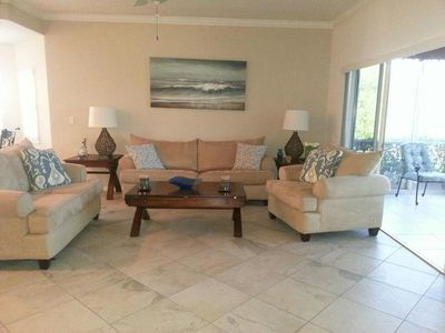 Photo for Minutes to the Beach- Ground Floor Coach Home