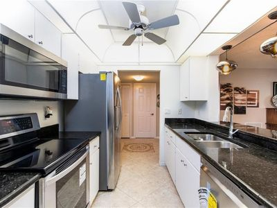 Photo for Spacious two bedroom condo, centrally located to amenities and beaches