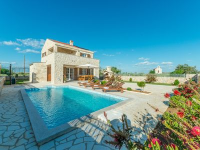 Photo for New stone villa with pool, 500 meters from the beach, sea view, large garden