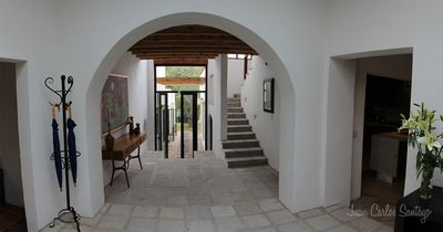 View when you enter front door. Kitchen and dining to right; small den to left