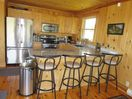 Fully equipped kitchen with stainless steel appliances at Havenside Cottage