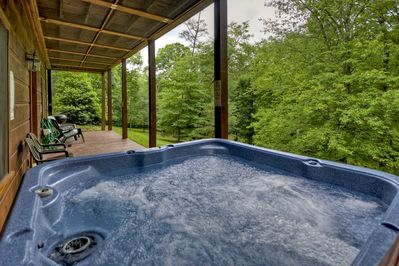 Relax in the hot tub after a long day of ziplining or whitewater rafting