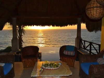 Watch the sunset from the living room of your own villa on the Pacific Ocean.