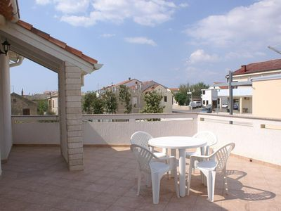Photo for Two bedroom apartment with terrace and sea view Povljana, Pag (A-233-a)