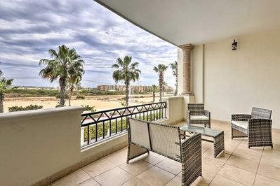 Sit on the balcony of this vacation rental and enjoy the ocean view!