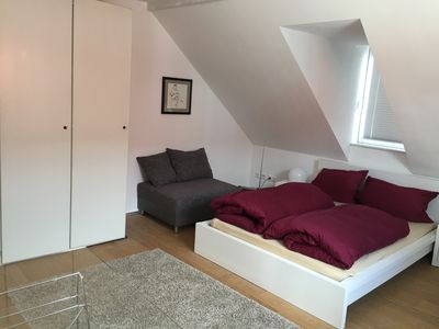 Photo for Modern, bright apartment close to the train station