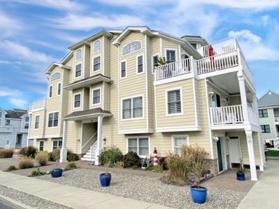 Photo for GREAT VIEWS!!!  Just steps to the beach and Promenade! Newer beachblock townhouse! 6 off street parking, outside shower and 2 zone central air. Gorgeous kitchen
