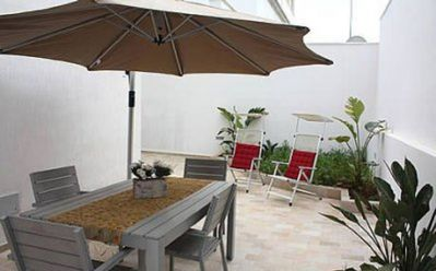 Photo for Holiday Apartment in Central Location with Terrace and Only a Few Meters from the Beach