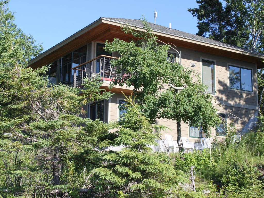Two Levels Tucked Into The Wooded Lake S With Extraordinary Views