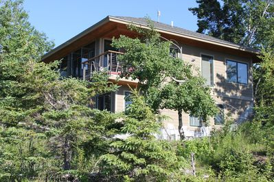 Two levels tucked into the wooded lake shore with extraordinary views