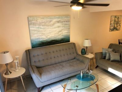 Modern design, the living area features a couch and loveseat.