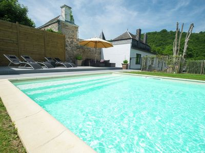 Photo for Charming holiday home along the Meuse with outdoor swimming pool
