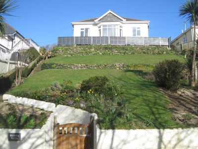 Photo for In the heart of Polzeath - A level 300m walk from beach, shops and restaurants