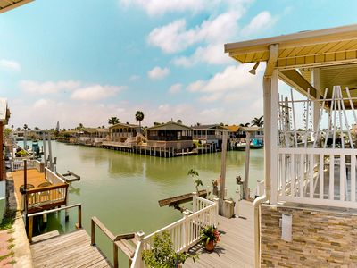 Photo for Waterfront home w/ private dock & shared pools/hot tub/gym - 2 dogs welcome!