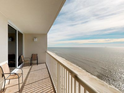 Photo for Beachfront condo with resort pool, gym & more - walk to the beach!