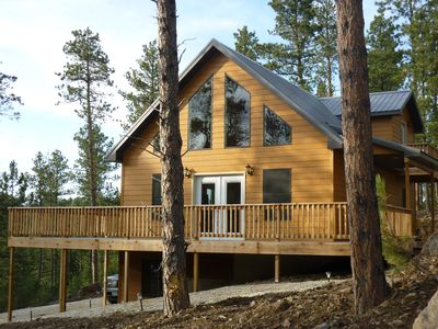 Photo for Beautiful New Cabin with large Deck and tucked into the hillside.  Relax & enjoy
