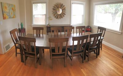 Huge dining room table can expand to easily seat 12