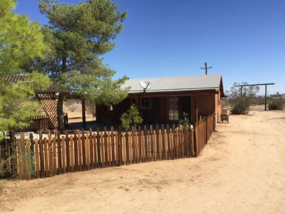 Cabin yard, frm inside the property. Drive-in gate on right is NE corner of prop
