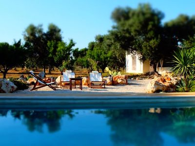 Photo for Stay in a Trullo in the middle of a secular olive grove