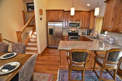 Kitchen with stainless steel appliances. granite countertops, breakfast bar.