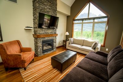 Living room with vaulted ceiling and mountain views