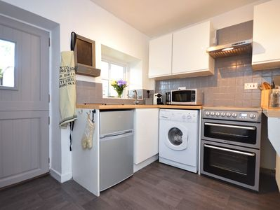 Well thought out kitchen space with door opening to your patio area