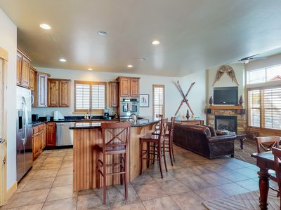 Photo for NEW LISTING! Townhome w/fireplace, private hot tub & shared pool/fitness center!
