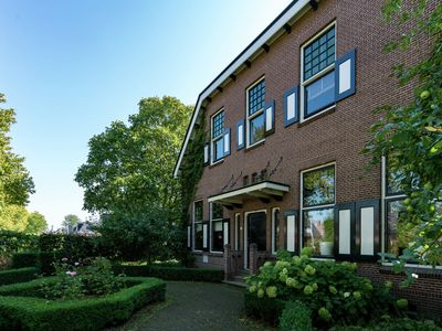 Photo for Monumental villa with Jacuzzi, steam shower and gym near the Wadden Sea