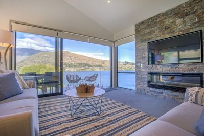 Stunning, lakefront views of Lake Wakatipu and The Remarkables mountains from the entertainment lounge.