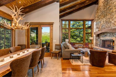 Upper Level Living Room with Fireplace and Deck Access, Large Dining Room Table with Seating for 8 people