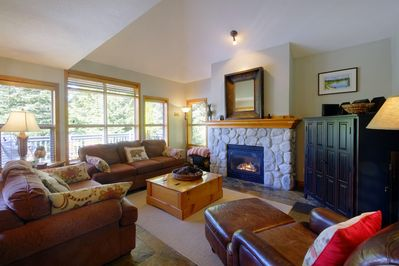 The cozy living room has games, DVD's, gas fireplace and a queen pullout couch.