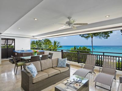 Photo for Beachfront Coral Cove apartment at Paynes Bay Beach
