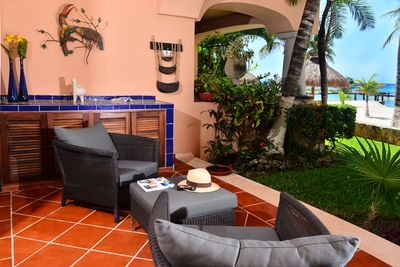Relax while the kids frolic on the beach just steps in front of the condo