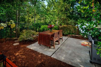 Outdoor setting next to green space.