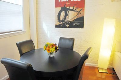 DINING TABLE WITH LEATHER CHAIRS SEATS FOUR