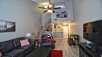 """Main living area with 55"""" TV and queen pullout sofa."""