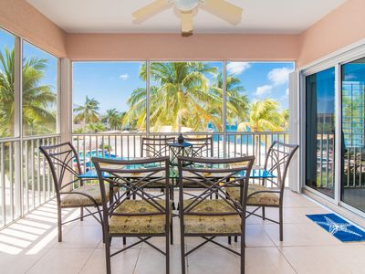 Photo for Serene & Well Appointed  Kaibo Beachfront Condo with Kayaks! by CaymanVacation