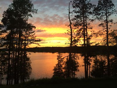 Sunset view overlooking lake from campfire area