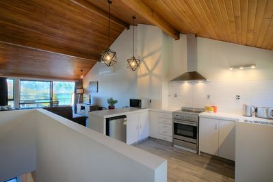 Fully equipped kitchen with brand new appliances, complimentary condiments and all the utensils you'll need to cook a great meal. Laundry area with washer, dryer and detergent and rear entry using the spiral staircase to landscaped gardens.